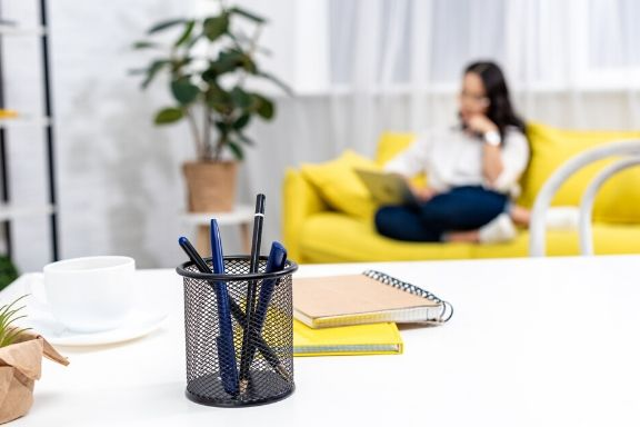 entrepreneur working from her home office/guest room sofa